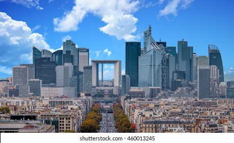 La Defense Financial District Paris France in autumn. Traffic on Champs-Elysees with orange and yellow trees aside. Modern vs. Old architecture