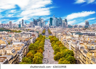 La Defense Financial District Paris France in spring. Traffic on Champs-Elysees with orange and yellow trees aside. Modern vs. Old architecture