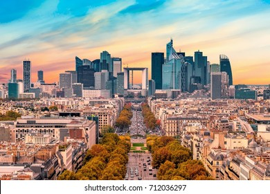 La Defense Financial District Paris France at sunset in autumn. Traffic on Champs-Elysees with green trees aside. Modern vs. Old architecture
