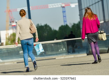 La defense, France- April 10, 2014:back view of two casual workers walking on a street. One wears pumps and the other black ballerinas