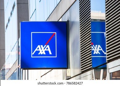 La defense, France - May 10 2015: Side view of Axa logo on a sign of building,. Axa is a French insurance and bank services company