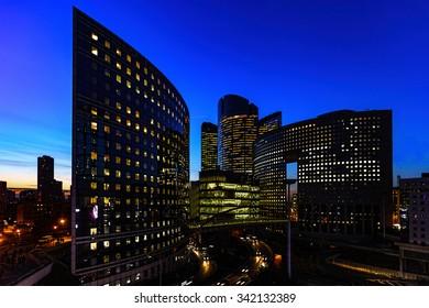 LA DEFENSE, PARIS BUSINESS DISTRICT, 26 October 2015 : Sunset at La Defense, Paris Business District with the office windows light on