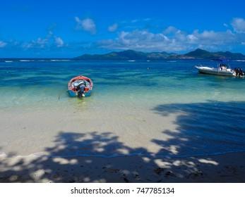 LA DIGUE, SEYCHELLES - SEPTEMBER 15 2017: Fishing boats and Indian ocean. La Digue island nature. Seychelles, Africa