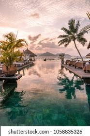 La Digue tropical island Seychelles, sunset by the swim pool of a luxury resort