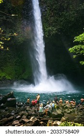 La Fortuna, Costa Rica - January 16, 2020 : Tourists and locals visiting the La Fortuna waterfall. This scenic waterfall is located in the rain forest of Tenorio volcano national park.