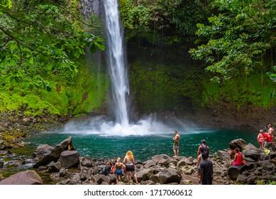 LA FORTUNA, COSTA RICA - MARCH 17, 2020: La Fortuna Waterfall in a forest, close to Arenal Volcano national park. Central America.