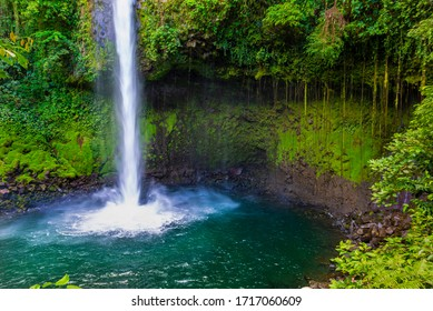 La Fortuna Waterfall in a forest, close to Arenal Volcano, Costa Rica national park. Central America.