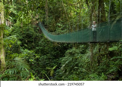 LA FORTUNA,COSTA RICA - CIRCA OCTOBER, 2006- Small child in Canopy walkway in Costa Rica, near La Fortuna