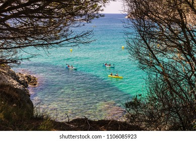 La Fosca beach with people practicing kayaking in Costa Brava, Girona, Catalonia, Spain