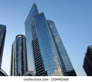 La Défense, France - July 1, 2019 - Tour First and Tour Alto in La Défense, two skyscrapers in the Business District of Paris