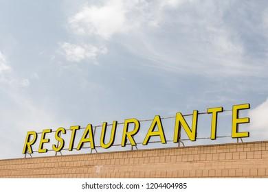 """La Gineta, Spain - SEPTEMBER 17, 2018: Restaurant sign in spanish. """"Restaurante"""" means """"Restaurant"""" in english"""