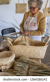 La Gomera, Canary islands - march 22, 2019: Old craftswoman working with the basketry typical of the island