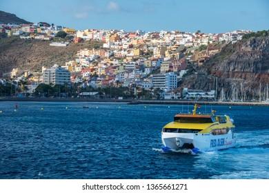 La Gomera, Canary islands - march 22, 2019: Ferry leaving the port with the city of San Sebastian de La Gomera in the background of the scene