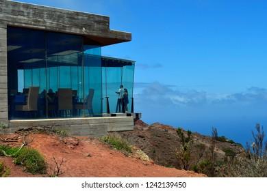 LA GOMERA, CANARY ISLANDS, SPAIN - APRIL 08: Unidentified couple by photo shooting in glass skywalk Mirador de Abrante on April 08, 2018 in La Gomera, Spain