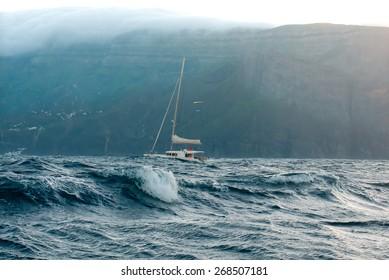 LA GOMERA, CANARY ISLANDS, SPAIN - 28 JANUARY 2014.Yacht catamaran in the stormy ocean near the island of La Gomera.
