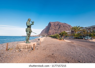 La Gomera, Spain - January 17, 2016: Statue of Hautacuperche, Guanche King, in Valle Gran Rey, La Gomera Island, Canary Islands, Spain. Hautacuperche was a guanche warrior who led an uprising against