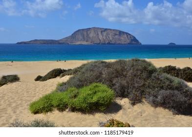 LA GRACIOSA, CANARY ISLANDS - SEPTEMBER 2018 - Island of Lanzarote from the beach Las Conchas