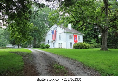 La Grange, Tennessee United States - July 14 2021: a large historic home with patriotic flags