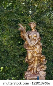 LA GRANJA DE SAN ILDEFONSO, SEGOVIA, SPAIN - OCTOBER 13,2018: sculpture of ceres goddess of agriculture, harvests and fertility carrying a spike over a background of green leafs