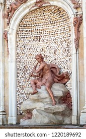 LA GRANJA DE SAN ILDEFONSO, SEGOVIA, SPAIN - OCTOBER 13,2018: sculpture of acteon playing a flute over a big rock in the fountain the baths of diana i