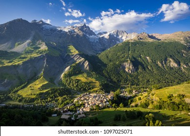 La Grave village with La Meije peak and glaciers in morning light. Ecrins National Park, Hautes-Alpes, French Alps, France