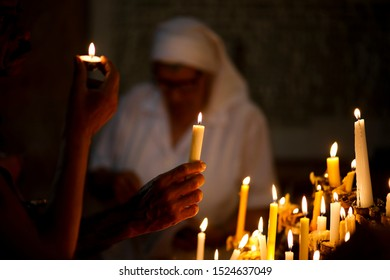 LA HABANA, CUBA - SEPTEMBER 8, 2019: A person holds a candle during the procession of the Virgin of Charity, the patron saint of Cuba.