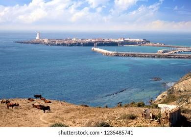 La Isla de las Palomas in the peninsula of Tarifa in Spain, the sothest point of Spain, and border between Mediterranean Sea and Atlantic Ocean.