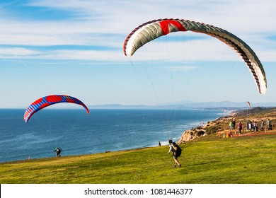 LA JOLLA, CALIFORNIA/USA - FEBRUARY 17, 2018:  Two pilots launch paragliders at the Torrey Pines Gliderport. Many Aviation pioneers have launched flights from the area, including Charles Lindbergh.