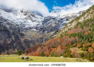 La Larri flats and waterfall in Ordesa and Monte Perdido National Park, Autumn scene, Huesca province, Spain