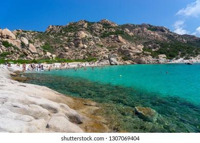 La Maddalena archipelago - August 2018: People swim and sunbathe at beautiful beach of archipelago la Maddalena. Sardinia, Italy