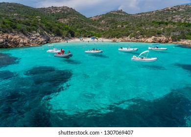 La Maddalena archipelago - August 2018: Yachts and boats anchored at beautiful beach of archipelago la Maddalena. Sardinia, Italy