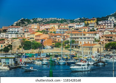 LA MADDALENA, ITALY. August 08, 2018: Port of La Maddalena in Italy. Boats, tourists and cars along the quay of the port situation in the south part of the island.