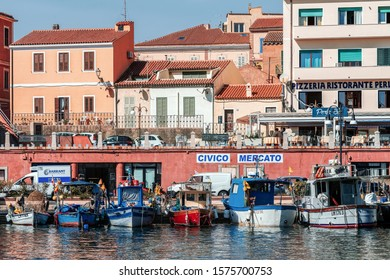 LA MADDALENA, ITALY – SEPTEMBER 13, 2019: Fishing boats moored in the port in La Maddalena,  the largest town in the Maddalena archipelago in the Straits of Bonifacio, between Italy and Corsica.