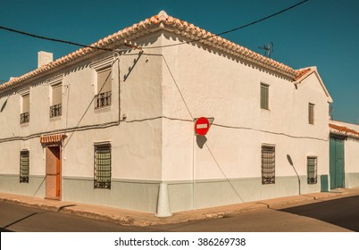 From La Mancha, rural Spain - Whitewash house at a corner street in a traditional Manchegan town in central Spain.