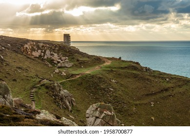 La Manche coastline landscape with WWII concrete nazi naval tower on the sunset, Saint Quen, bailiwick of Jersey, Channel Islands