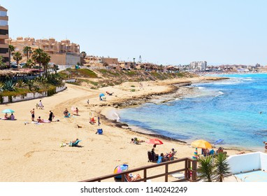 La Mata, Spain - June 25, 2018: Cala de Cabo Cervera beach in the Torrevieja resort town. Costa Blanca. Spain