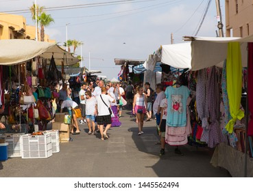 LA MATA, TORREVIEJA, SPAIN-JUNE 26th 2019: Spanish street market busy with people buying and selling at La Mata, Torrevieja, Spain on Wednesday 26th June 2019