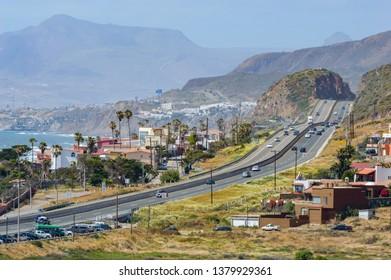 La Mision, Baja California, Mexico - 04/21/2019: Mexico Highway 1 and beach at La Mision during Semana Santa (Mexican holy week holiday)