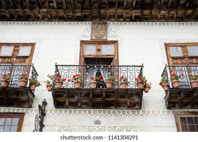 La Orotava, Tenerife, Spain - September 17 2016: Wooden oldfashioned balcony with flower pots at la Casa de los balcones
