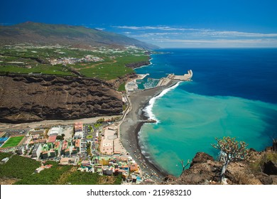 La Palma, Canary Islands, view from viewpoint Mirador el Time towards Puerto de Tazacorte with chirned up sand stain on the ocean