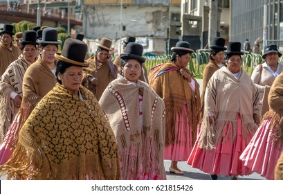 LA PAZ, BOLIVIA - April 30, 2016: Traditional Women (Cholitas) in Typical Clothes during 1st of May Labor Day Parade - La Paz, Bolivia