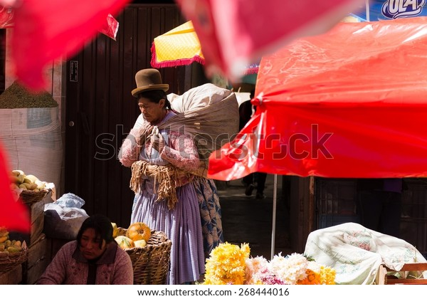 LA PAZ, BOLIVIA March 21, 2015: a lady wearing traditional clothes in a market