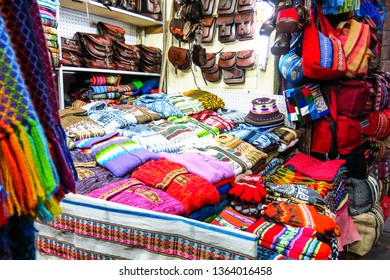 LA PAZ, BOLIVIA - MAY 20, 2015: Souvenir tourist market on Sagarnaga street in La Paz, Bolivia. Predominate handmade products, llama wool or sheep.