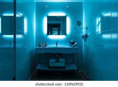 LA PAZ, BOLIVIA - OCTOBER 17, 2017: Modern bathroom interior with flashy blue lights in the modern city center of La Paz.