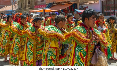 LA PAZ, BOLIVIA - OCTOBER 18, 2017: Cultural event in the city of La Paz with young men and women wearing colorful traditional clothing and hats.