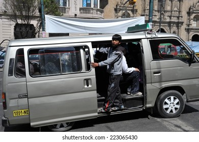 LA PAZ, BOLIVIA - SEPTEMBER 12, 2010: Actual capital  of Bolivia. The majority of the population is illiterate. Therefore in public transport there are barkers who are shouting a bus route.