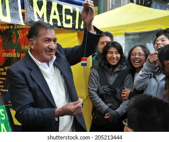 LA PAZ, BOLIVIA - SEPTEMBER 5, 2010: Large high city and actual capital in the Central part of South America. The majority of the population lives in poverty. Street magician.