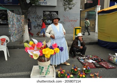 LA PAZ, BOLIVIA - SEPTEMBER 5, 2010: Large high city and actual capital in the Central part of South America. The majority of the population lives in poverty. Women selling on the street of La Paz.