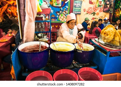 La Paz, Bolivia-Jan 1, 2019: Cook cooking at a night street fair in La Paz, Bolivia.