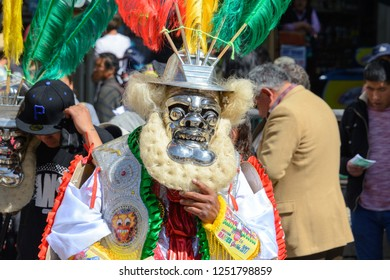 LA PAZ, JULY 31: Unidentified dancer wears a mask and traditional dress  in a festival parade, July 31, 2017 in La Paz, Bolivia